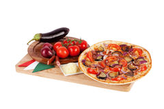 Italian pizza with eggplant, tomatoes, sausages, cheese, onion Stock Photos