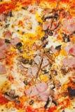 Italian pizza with fungi and ham Royalty Free Stock Photos