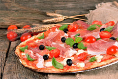 Italian pizza with ham and mozzarella cheese Stock Images