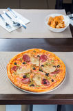 Italian pizza. With ham tomato and olives Royalty Free Stock Photos