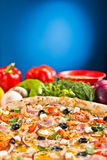 Italian pizza with ham and vegetables Stock Photo