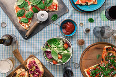 Italian pizza, hot dog grilled, salad, red wine and lager Stock Images