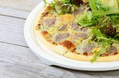 Italian pizza with house sausage and artichokes Stock Photo