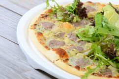 Italian pizza with house sausage and artichokes Stock Images