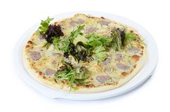 Italian pizza with house sausage and artichokes Stock Photography