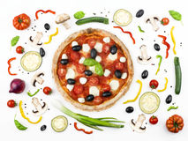 Italian pizza with its ingredients. Composition of Italian pizza with its ingredients Royalty Free Stock Photo