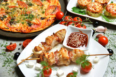 Italian pizza kebab bbq tomatoes olives garlic on wooden rustic Stock Images