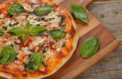 Italian pizza margarita Royalty Free Stock Image