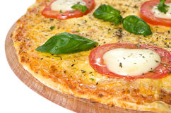 Italian pizza margherita on a wooden board. With cheese mozzarella and basil Royalty Free Stock Photography