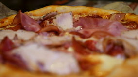 Italian pizza with meat, bacon, pepperoni, cheese. Italian pizza with meat, bacon, pepperoni and cheese close up. 4K UHD video footage stock video