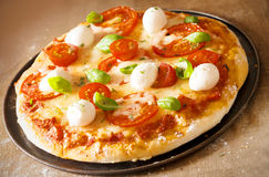 Italian pizza with mozzarella cheese Royalty Free Stock Photo
