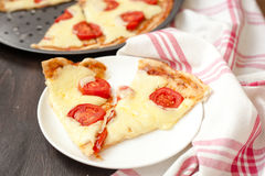 Italian pizza with mozzarella cheese and tomatoes, Margarita Royalty Free Stock Image