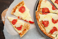 Italian pizza with mozzarella cheese and tomatoes, Margarita Stock Photography