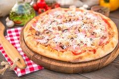 Italian Pizza with mushroom. Pizza with mushroom ham and cheese Stock Photography