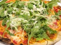 Italian pizza. Pizza with mushrooms arugula and Parmesan Stock Photos