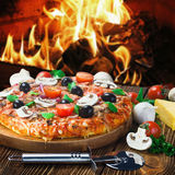 Italian pizza with mushrooms and cheese served Stock Images