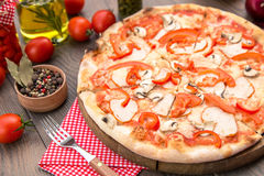 Italian Pizza with mushrooms. Peppers and meat Stock Images