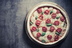 Italian pizza at old surface Royalty Free Stock Photos