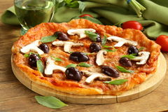 Italian pizza with olives and mushrooms Stock Photography