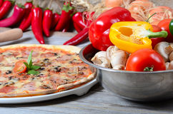 Italian pizza with olives and salami Stock Photo