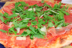 Italian pizza with parmesan, rucola and prosciutto Royalty Free Stock Photo