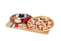 Italian pizza with pineapple, chicken, grill, red, purple, onion Royalty Free Stock Photo