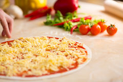 Italian pizza preparation Royalty Free Stock Photos