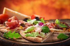 Italian pizza primavera served on wooden table Royalty Free Stock Image