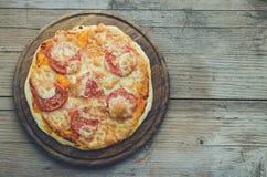 Italian pizza with prosciutto and arugula stock image