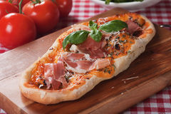 Italian pizza with prosciutto Royalty Free Stock Photo