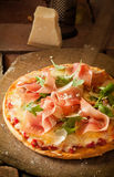 Italian pizza with prosciutto and rocket Royalty Free Stock Photography