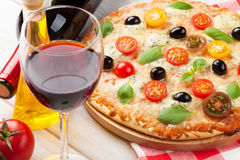 Italian pizza and red wine Stock Photos