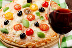 Italian pizza and red wine Royalty Free Stock Photos