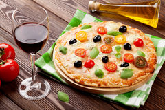 Italian pizza and red wine Stock Images