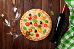 Italian pizza and red wine Stock Photography