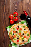 Italian pizza and red wine Royalty Free Stock Photography