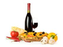 Italian pizza with red wine and ingredients Royalty Free Stock Photo