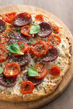 Italian pizza with salami and tomatoes, top view Royalty Free Stock Photos