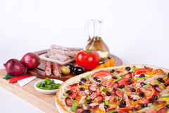 Italian pizza with sausage, beef, green beans, stock image
