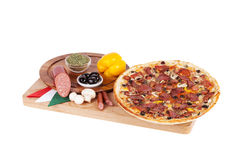Italian pizza with sausage, salami, olive grass, herbs of Proven Stock Photos