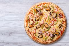 Italian pizza with seafood closeup top view Stock Photos