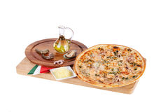 Italian pizza with seafood, octopus, mussels, shrimp, king, chee Royalty Free Stock Photography