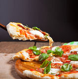 Italian pizza served on wooden table Stock Photography