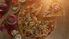 Italian pizza served on wooden table, top view. stock video footage