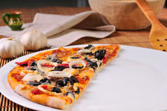 Italian pizza slice on table Royalty Free Stock Photo