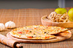 Italian pizza slice on table Stock Photography