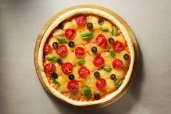 Italian pizza at table surface Stock Photo