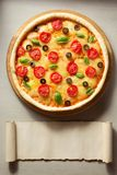 Italian pizza at table surface Royalty Free Stock Photography