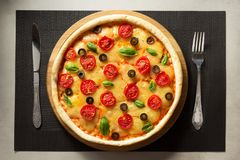 Italian pizza at table surface Royalty Free Stock Image