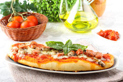 Italian pizza with tomato and basil Royalty Free Stock Photos